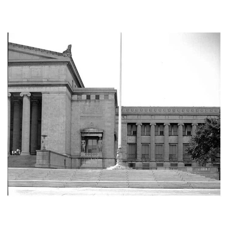 Northwest corner of The Field Museum exterior, including flagpole, torchere lamps and caryatid figures.