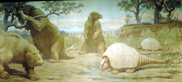 A Charles Knight mural depicting three ground sloths and two glyptodonts as they forage for food and water.