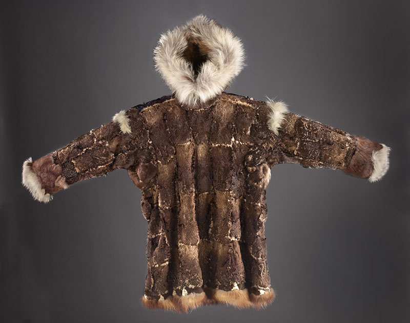A brown and white coat made from animal skin and fur