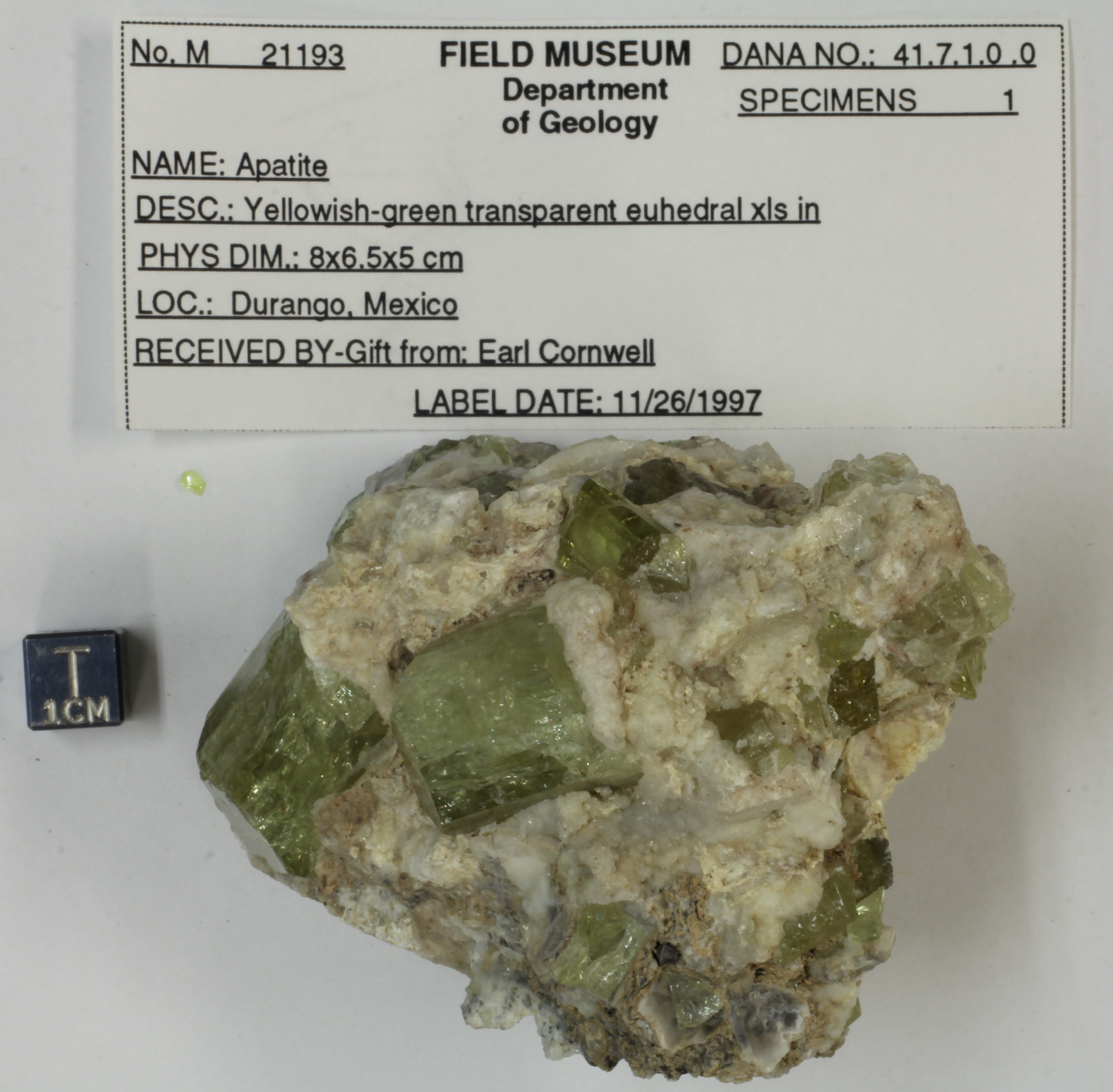 A stone with chunks of green mineral