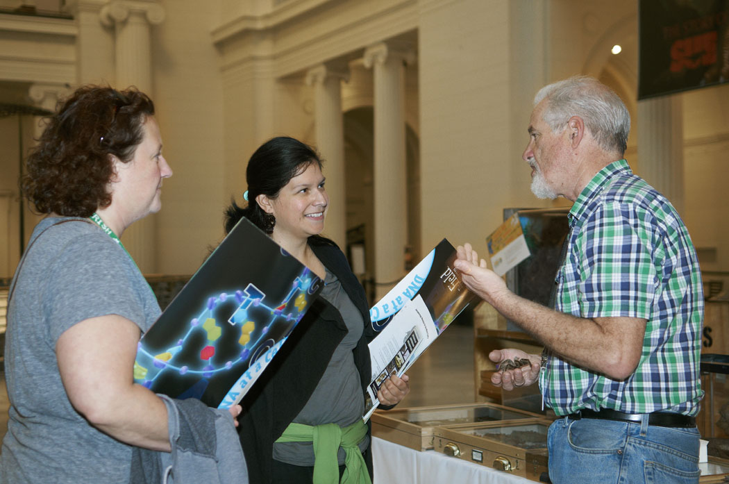 Educators visiting during an open house listen to a Field Museum staff member.