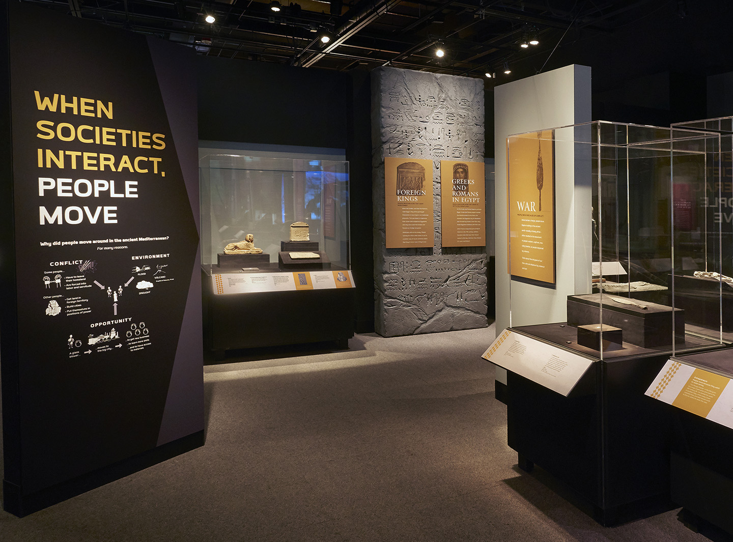 View of Ancient Mediterranean Cultures in Contact exhibition, showing a large panel reading