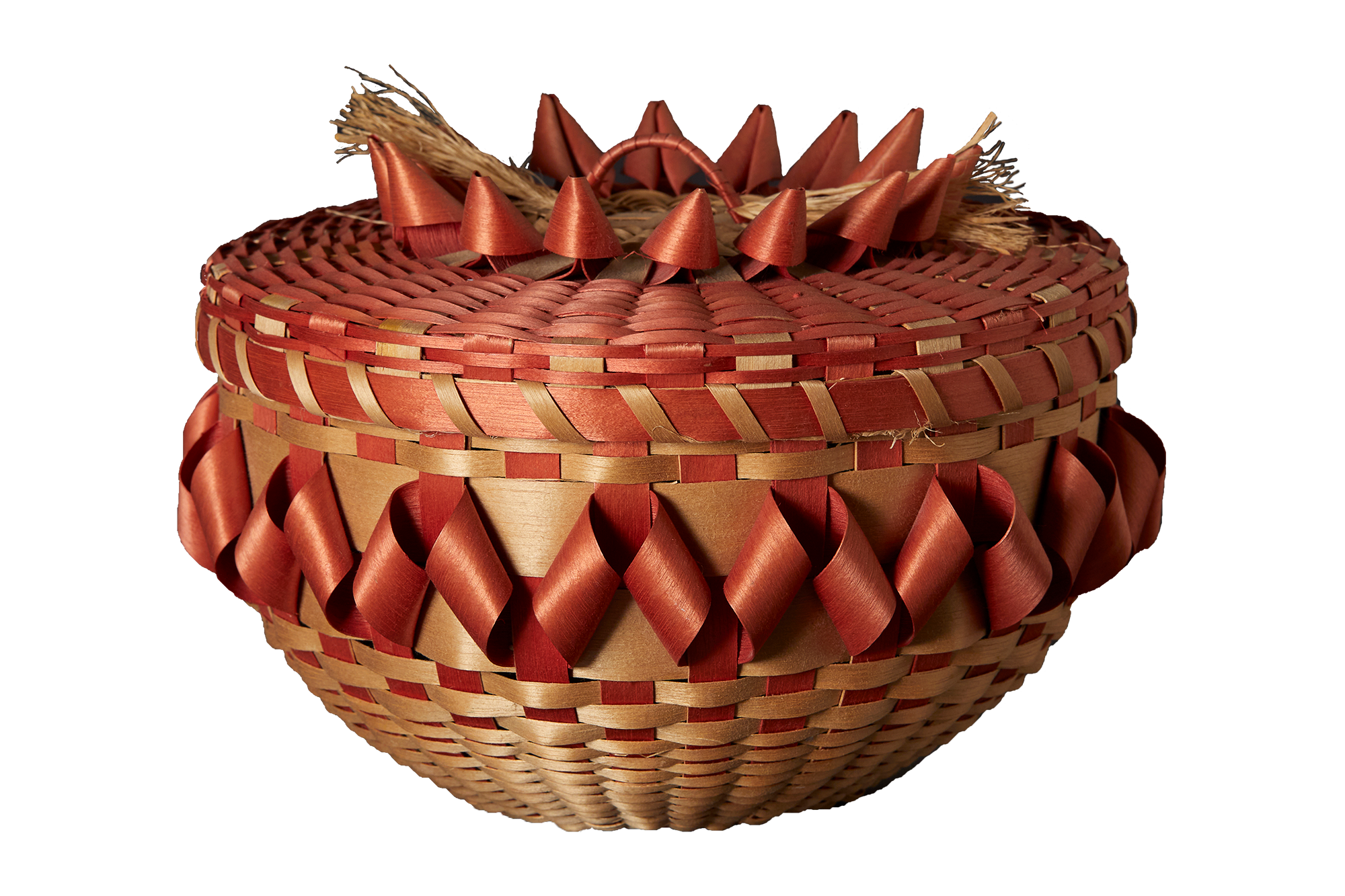 A woven tan and red basket.