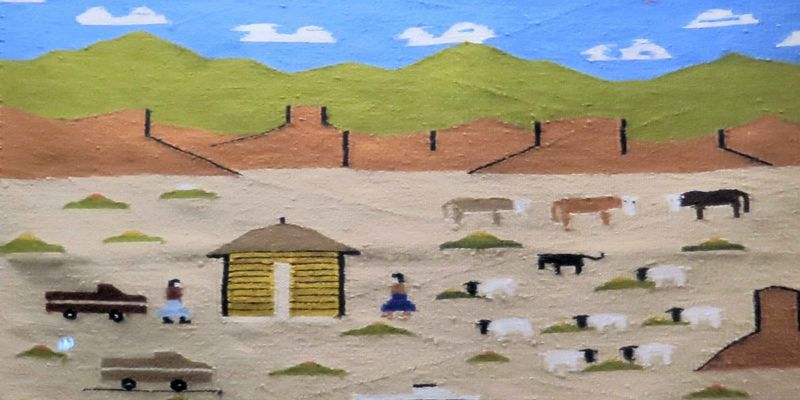 A section of a rug with stylized depictions of blue sky with clouds, green and brown mountains, and farmland with cows