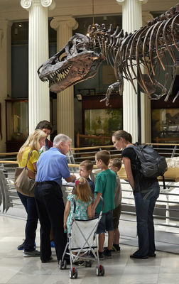 Docent talks with visitors about SUE the T.rex