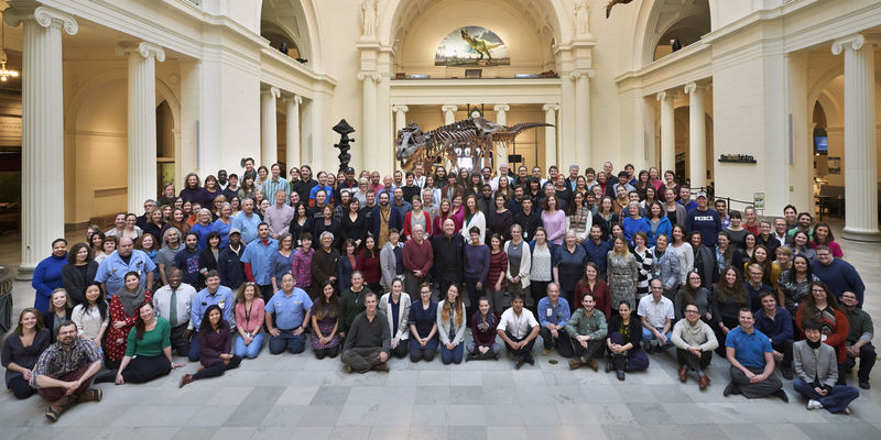 Large group of Museum employees in Stanley Field Hall