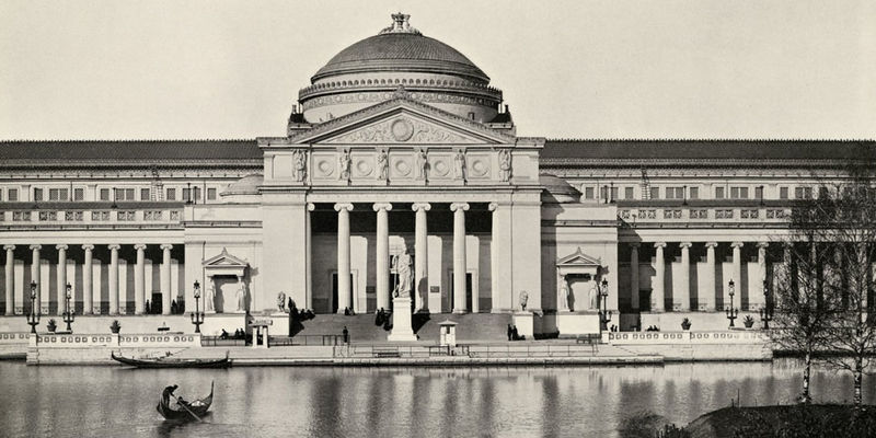 South facade of the Palace of Fine Arts building from the World's Columbian Exposition, Chicago, 1893. Gondola boats in the lagoon and people on stairs.