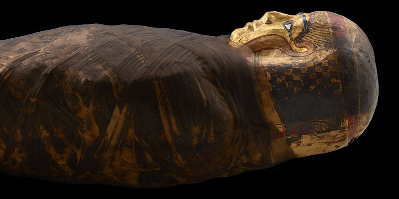 "Egyptian mummy, known as the ""Gilded Lady,"" in gold gilded cartonnage"