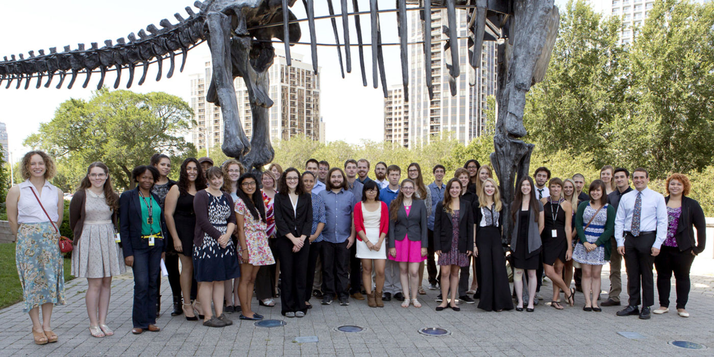 Undergraduate students in the 2014 REU program pose on the Museum's terrace in front of our replica Brachiosaurus skeleton.