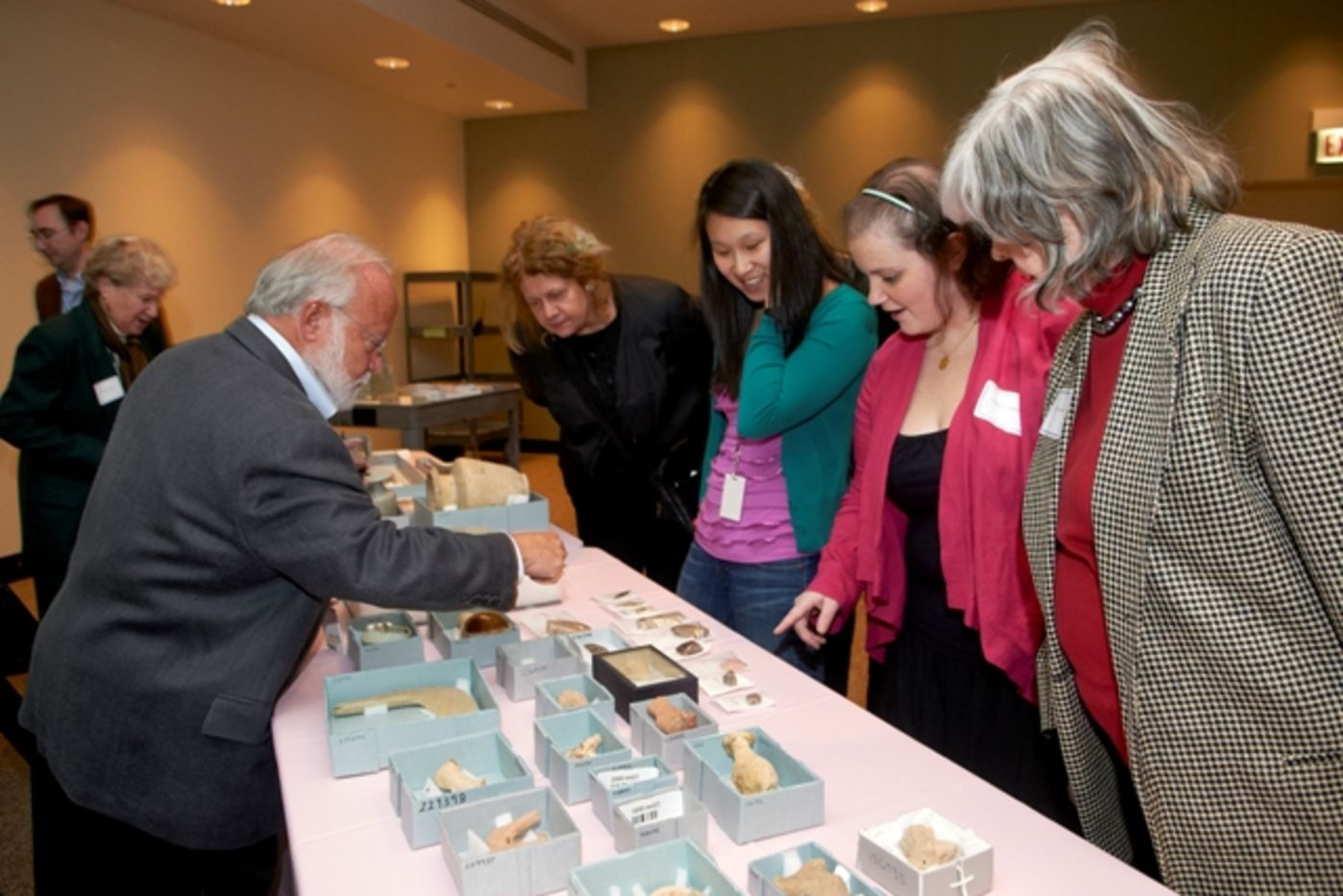 Women look at objects from the Museum's anthropological collections.