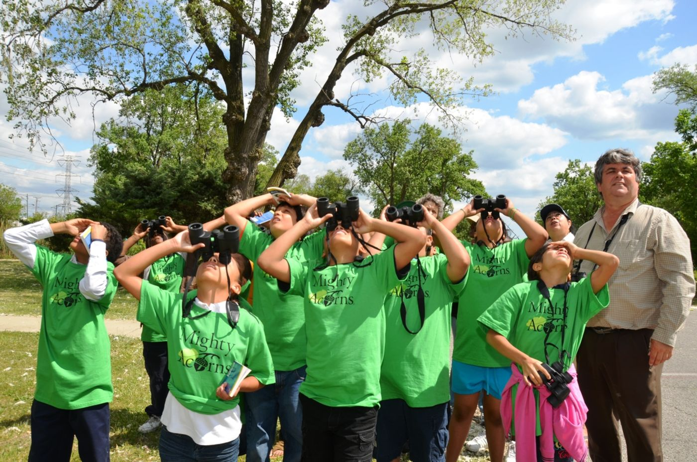 Mighty Acorns Students Looking Through Binoculars