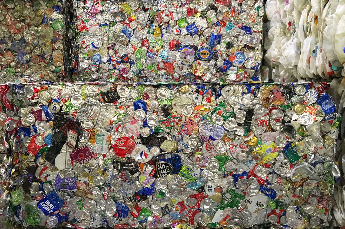Stacked blocks of aluminum cans that have been crushed and compacted.