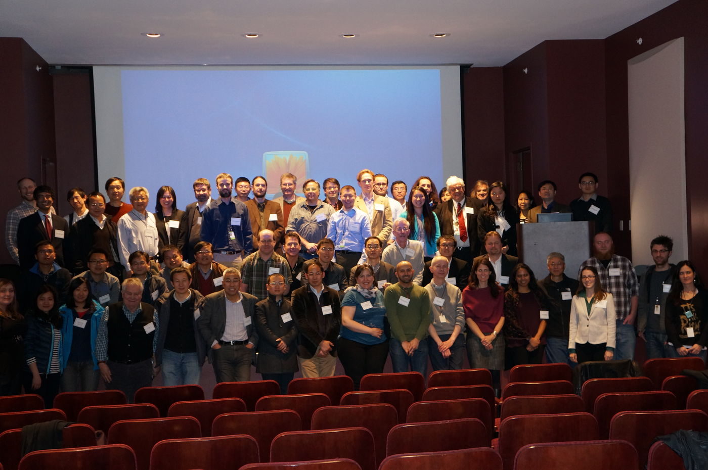 Group of participants in 2015 Critical Transitions workshop gathered on stage