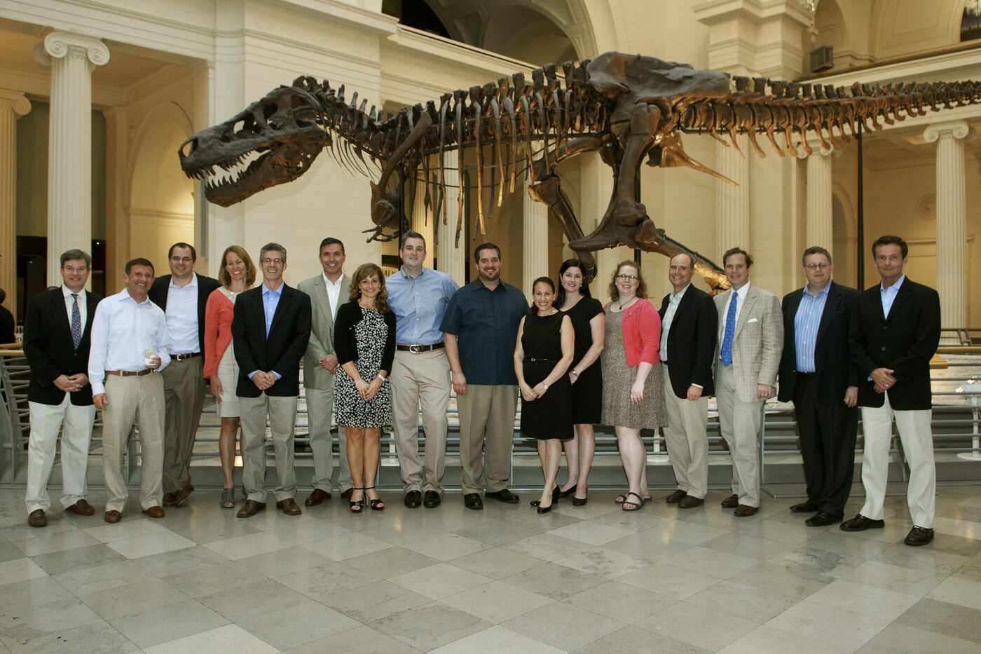 Members of the President's Leadership Council pose in front of SUE the T.rex.