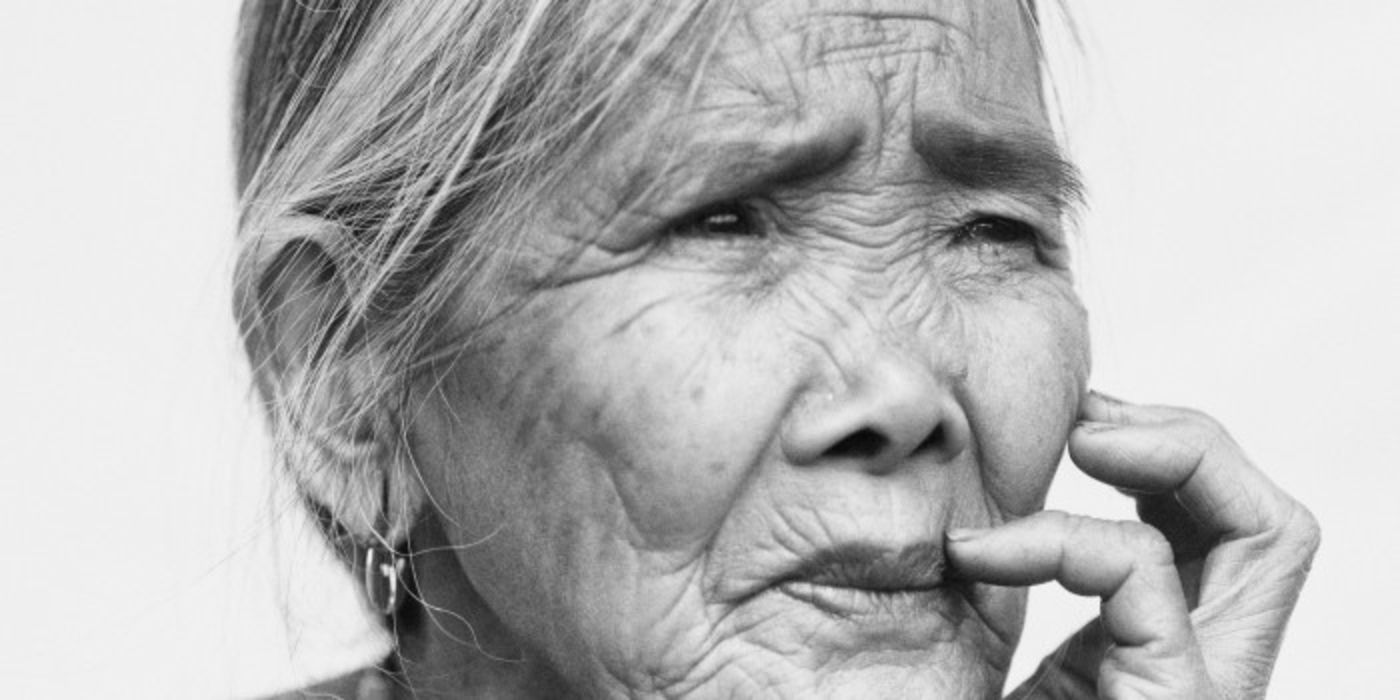"""Portrait of Whang-od Oggay, a master tattoo artist of the Kalinga people of the Philippines, as featured in the Museum's member magazine """"In the Field."""""""