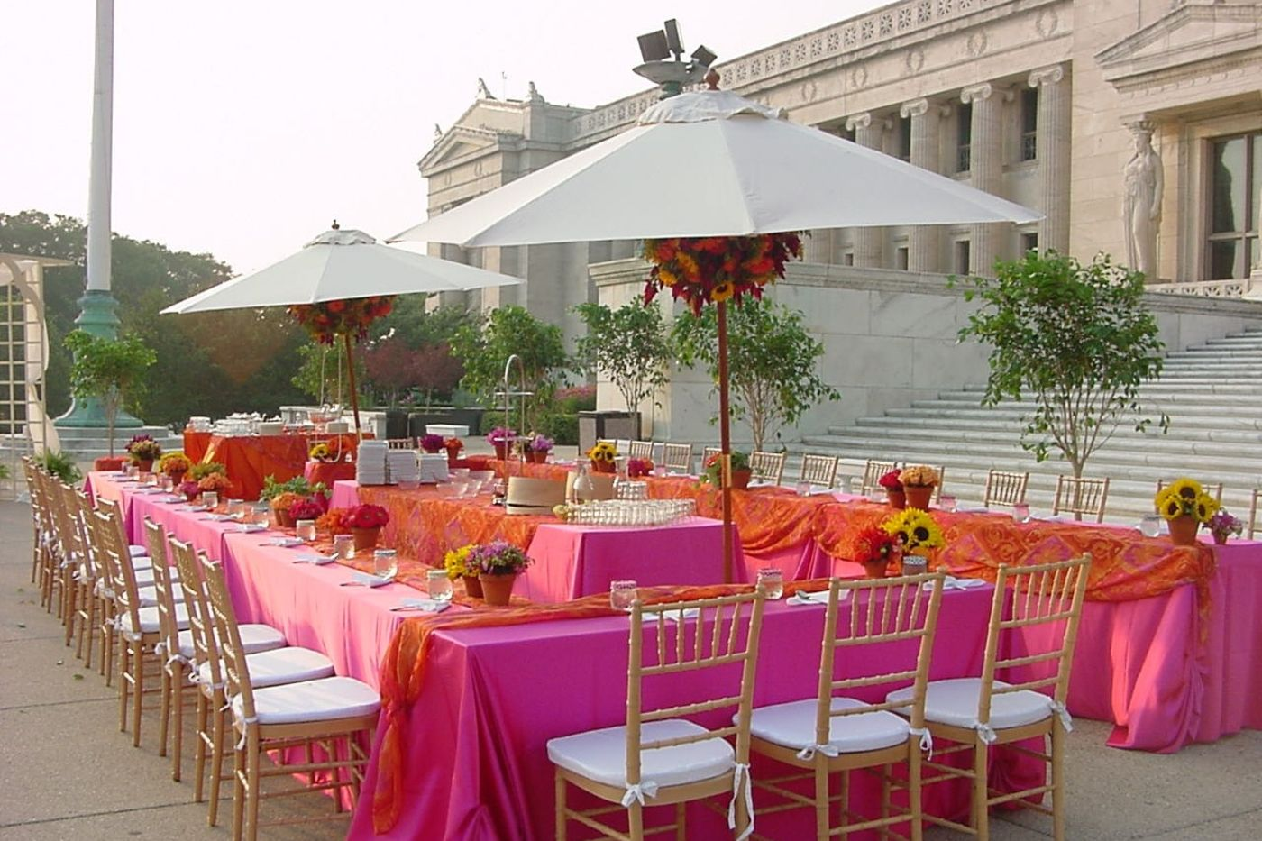 Tables and chairs with custom decor set up for a special event on the Museum's Northeast Terrace.