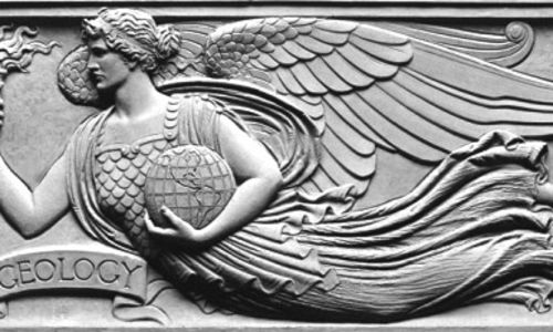 A low relief panel, or frieze, by Henry Hering depicting a winged female figure wearing a flowing gown and holding a globe with North and South American continents and a torch representing fire.