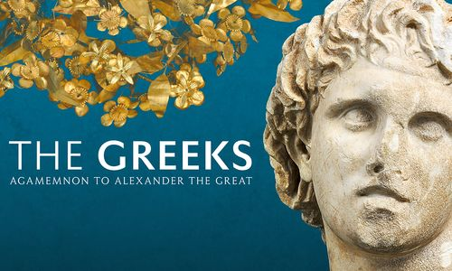 Greeks Exhibition logo, featuring a stone portrait of Alexander on the right and a gold myrtle wreath on the upper left.