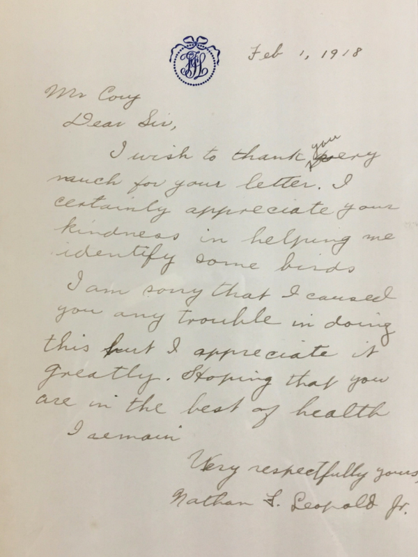 Handwritten letter with a blue monogram seal at the top of the page